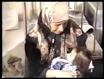 Iraqi woman and child from 1996 60 Minutes broadcast.