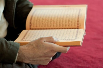 Man reading Qur'an