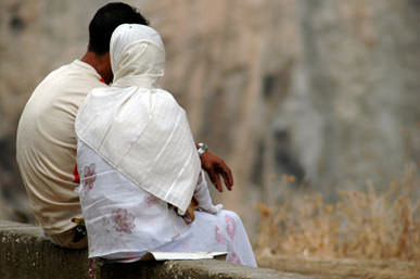 muslim-couple-sitting-close