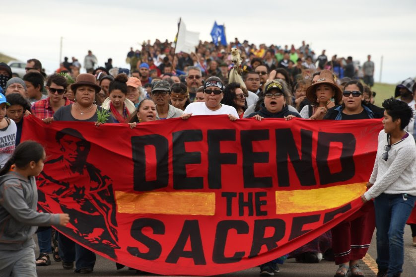 Native Americans march to a burial ground sacred site that was disturbed by bulldozers building the Dakota Access Pipeline (DAPL), near the encampment where hundreds of people have gathered to join the Standing Rock Sioux Tribe's protest of the oil pipeline that is slated to cross the Missouri River nearby, September 4, 2016 near Cannon Ball, North Dakota. Protestors were attacked by dogs and sprayed with an eye and respiratory irritant yesterday when they arrived at the site to protest after learning of the bulldozing work. / AFP PHOTO / Robyn BECKROBYN BECK/AFP/Getty Images