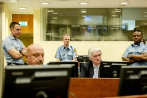 Bosnian Serb wartime leader Radovan Karadzic, 2nd right, in the courtroom for the reading of his verdict at the International Criminal Tribunal for Former Yugoslavia (ICTY) in The Hague, The Netherlands Thursday March 24, 2016. The former Bosnian-Serbs leader is indicted for genocide, crimes against humanity, and war crimes. (Robin van Lonkhuijsen, Pool via AP)